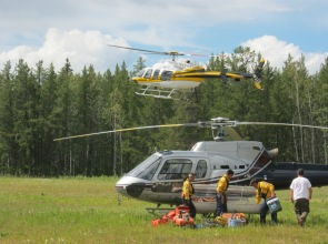 fire crew loading helicopter