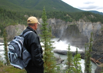 man looking at falls