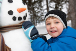 child with a snowman