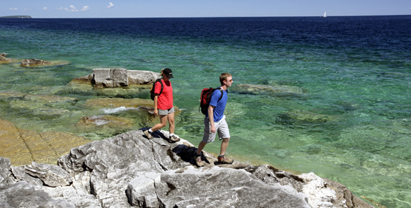 hikers along the blue waters of georgian bay