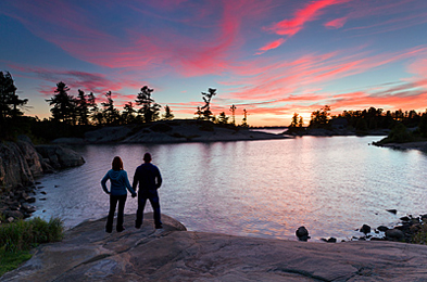 A couple on the shoreline of Georgian Bay