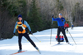 A family doing cross-country skiing.
