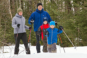 A family making snowshoeing.