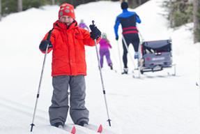 A boy doing cross-country skiing.