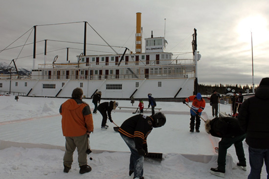 Clearing the ice at the S.S. Klondike National Historic Site