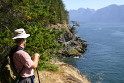 Hiker overlooking coastal bluff