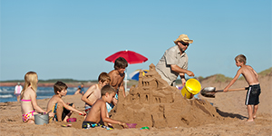 Children participate in a sandcastle-building activity at the Cavendish beach.