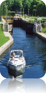 Boat gliding along Youngs Point at Lock 27, Trent-Severn Waterway National Historic Site