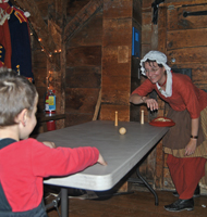 A woman in costume and a little boy playing ping-pong.