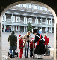 A family is greeted by a soldier at the Halifax Citadel.