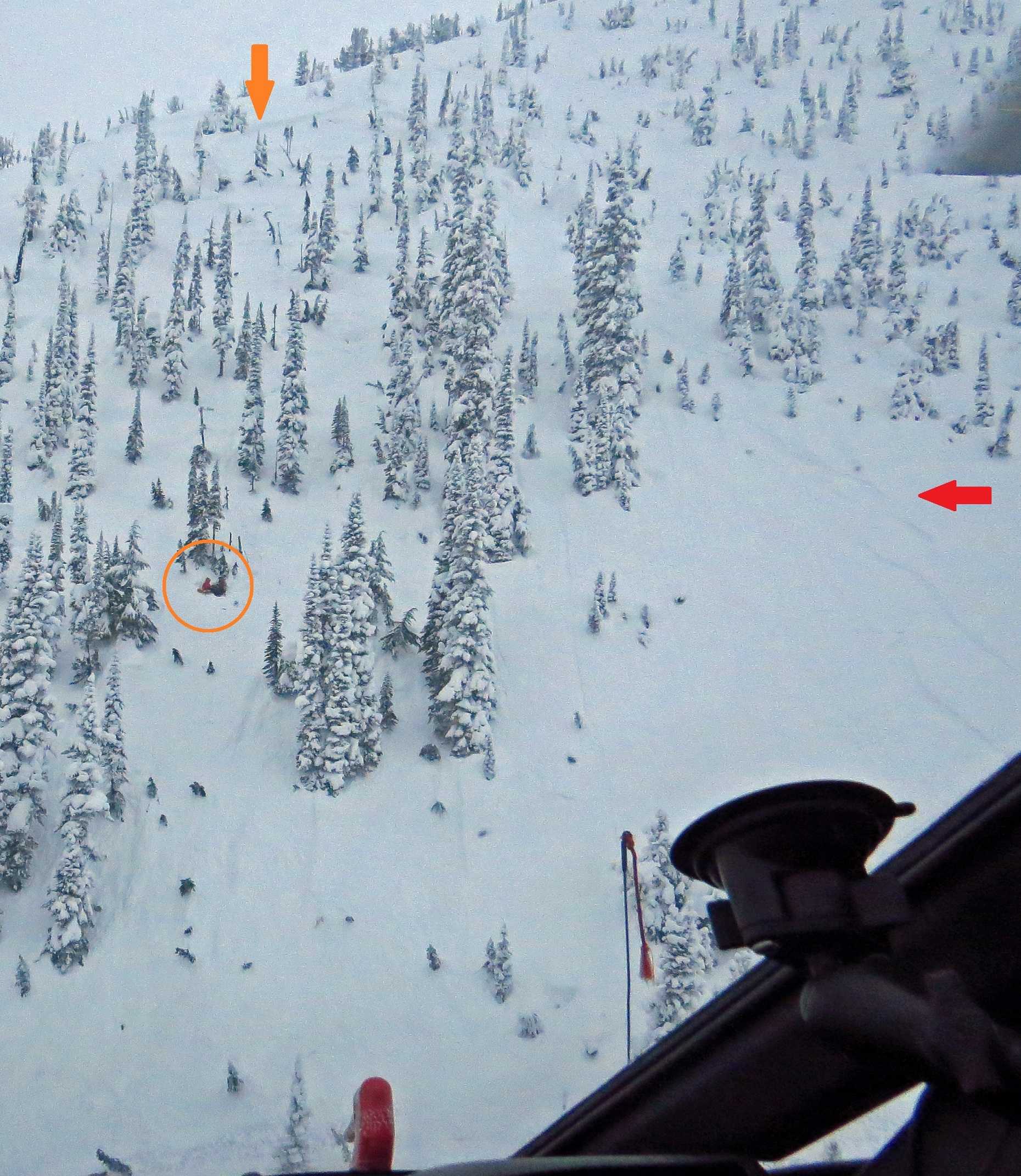 Photo of avalanche showing fracture line, ski tracks and skier location