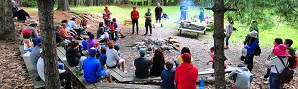 Participants gathered around a bonfire at Learn to Camp