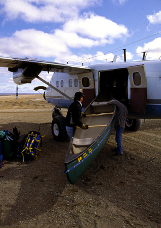 Loading canoes onto a Twin Otter plane