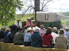 tour group viewing an outdoor ranch demonstration