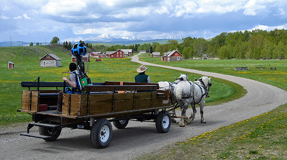 One of Google's Street View operators gets a wagon ride at the Bar U Ranch