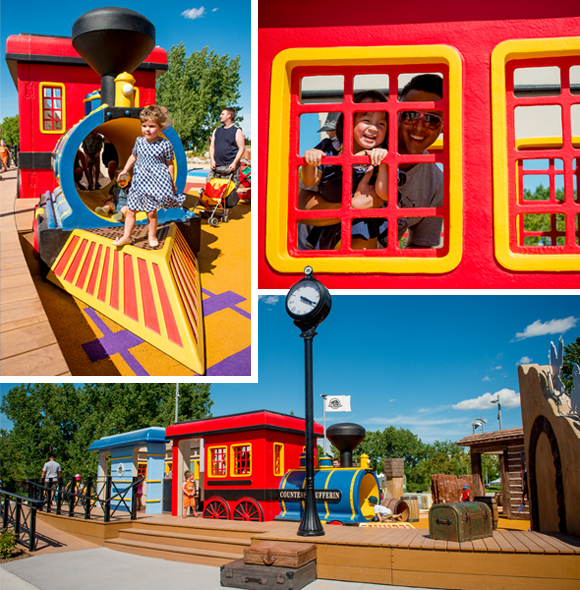 Children playing on the colourful train in the Railway/Iron Horse zone of the Variety Heritage Adventure Park