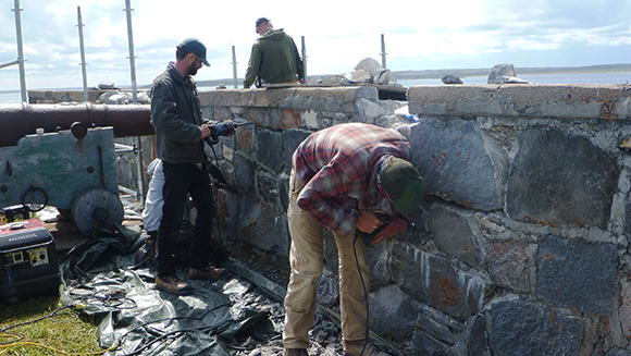 Heritage masonry students from Algonquin College's Perth, Ont. campus work on restoring the fortifications at Cape Merry Battery, which is part of Prince of Wales Fort National Historic Site.