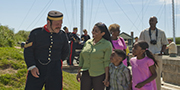A guide provides visitors with a guided tour of the Halifax Citadel National Historic Site.