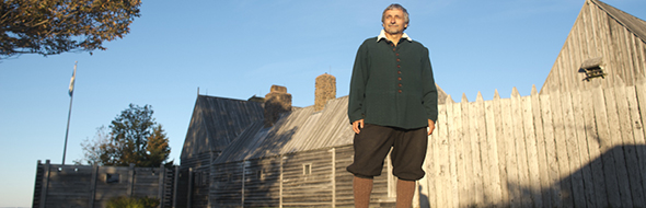 Interpreter standing in front of the Habitation at Port-Royal National Historic Site.