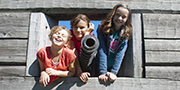 Kids having fun with a cannon at the Habitation at Port-Royal National Historic Site.