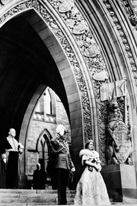 H.M. King George VI and Queen Elizabeth leaving the Parliament Buildings after giving Royal Assent to Bills in the Senate Chamber; Rt. Hon. W.L. Mackenzie King in the background, 1939.