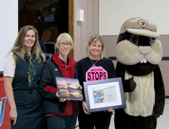Parks Canada staff Pamela Jalak and Jeanette Cowen present Jackie Barrett with Parks Canada Ambassador for Education Award