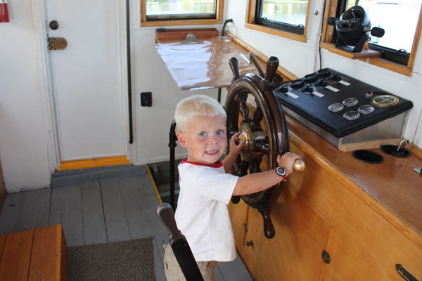 Young Visitor Enjoys the Tug Trent