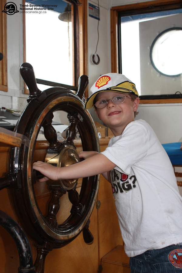 Trent drives the Trent! Kids love coming aboard the tug to try out the steering wheel.