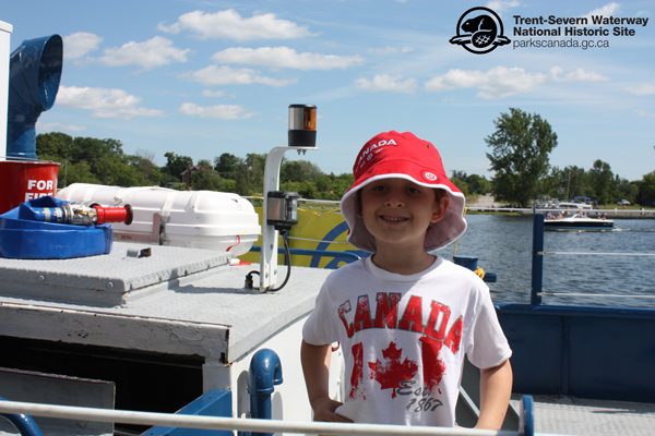 A young visitor celebrates Canada Day on the Tug Trent in Hastings. Yet another beautiful day on the Trent-Severn Waterway!