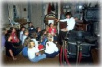 Grade 3 class in historic kitchen.