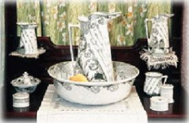 This wash set includes a basin, pitchers, a soap dish and a toothbrush jar.