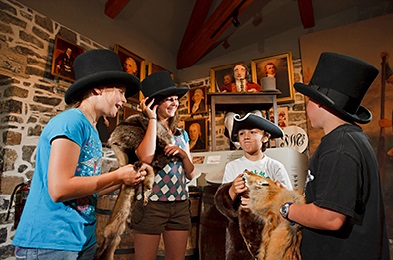 A group of young people are having a fun The Fur Trade at Lachine National Historic Site