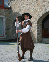 A Carignan-Salières soldier getting ready to fire the musket