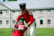 A British soldier and a little girl at Fort Lennox