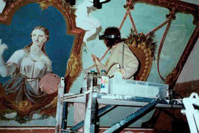 Restorers at work on the eastern wall of Napoléon Bourassa's studio