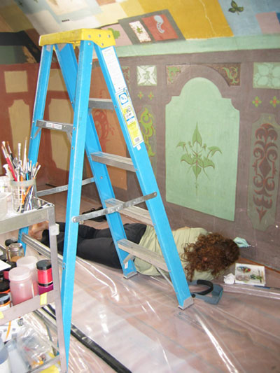 Restorers at work on the western wall of Napoléon Bourassa's studio