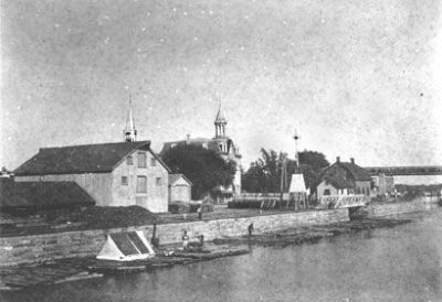 Timber rafts at Ste-Anne-de-Bellevue Lock. April 18, 1916