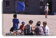 A group of children waving a flag