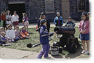 Children learning how to prepare a canon