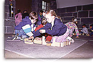 Children trying to build a fort with wood blocks