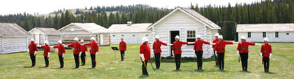 Parks Canada employees dressed in period NWMP costumes performing military drills.