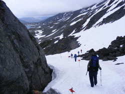 Traversing a snowfield en route to Crater Lake