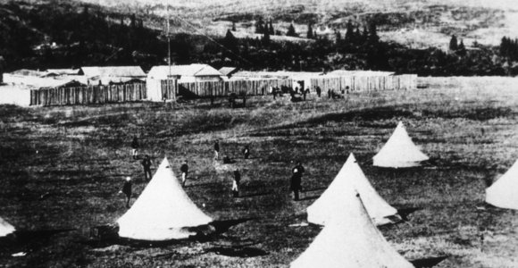 Image of Fort Walsh with tents sent up in foreground