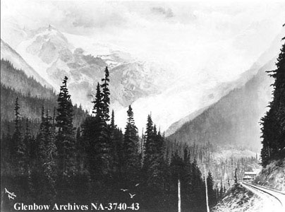 Historic image of railway line, mountains and Glacier House