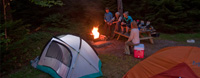A group of friends enjoying a campfire at their campsite