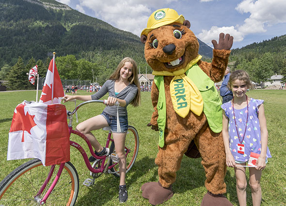 Two young visitors enjoy Canada Day with Parka, our mascot