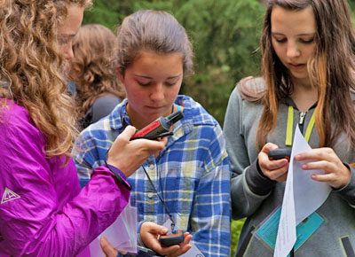 students explore with the help of a GPS