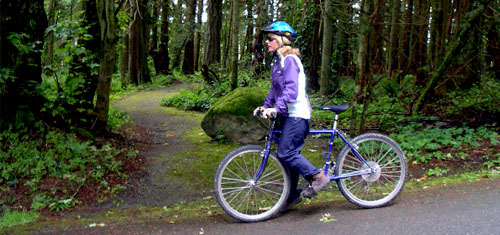 A woman cycling in the Gulf Islands National Park Reserve