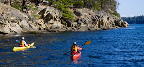 A couple kayaks along the beach of the Gulf Islands National Park Reserve