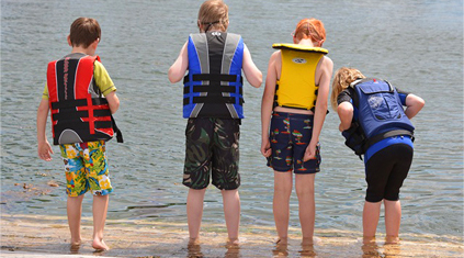 Four boys with life jackets on